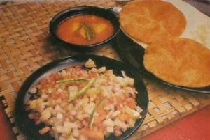 Anda Aaloo Dum With Puris at PakiRecipes.com
